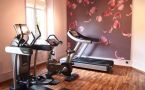 fitness room with exercise equipment