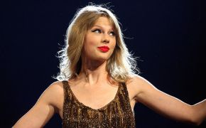 Taylor Swift at performance in gold dress