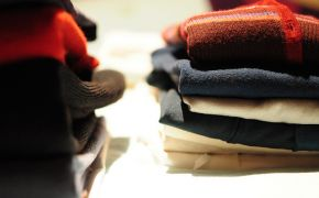 neatly folded sweaters in a stack