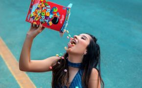 Girl dumping box of breakfast cereal into her mouth
