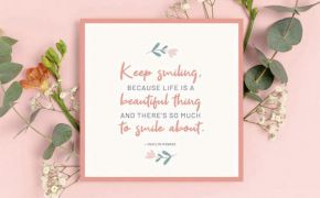 A quote from Marilyn Monroe in calligraphy on card in front of pink wall and flowers