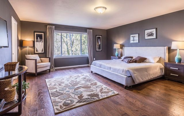 Bedroom with wood floors and new furniture