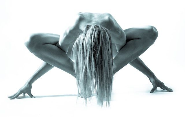 WOman in complex yoga pose like she's tied in a knot