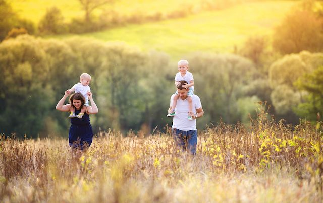 Parents with kids in meadow