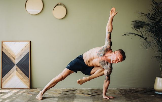 Man stretching and working out in his living room.