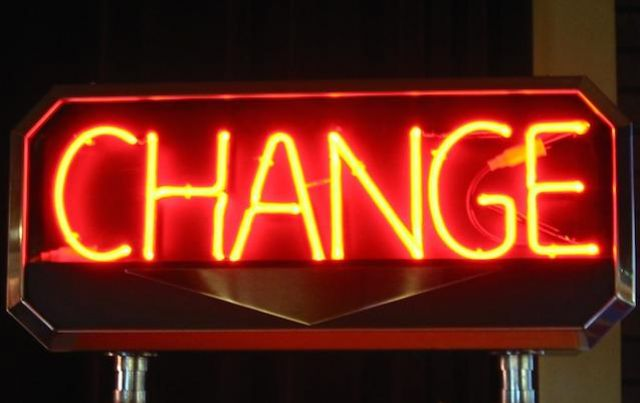 red neon sign reads: CHANGE