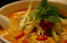 Close up on bowl of gluten free coconut curry soup.