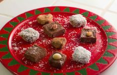 homemade chocolate fudge on red and green Christmas platter