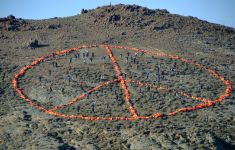 Refugee life jacket art peace sign in Lesbos
