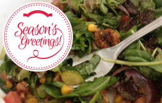 """fork in salad with overlay reading """"Season's Greetings"""""""