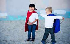 kids in capes dressed as superheroes
