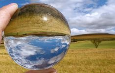 crystal ball with refracted image of hillside