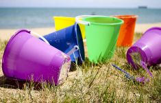plastic beach pails on the sand at beach