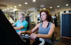 Male and female baby boomers working out at the gym