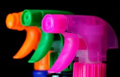 Three brightly colored spray bottle nozzles.
