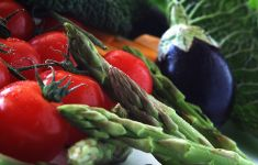 Colorful vegetables: eggplant, asparagus, tomatoes.
