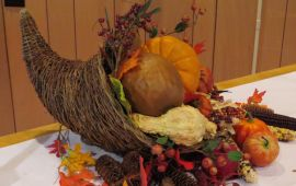cornucopia, harvest vegetables and gourds on table