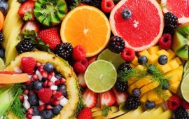 Large array of cut fruits in a colorful pile.