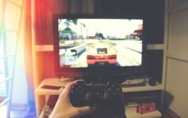Person playing a car video game