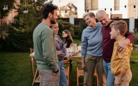 Family embracing at outdoor party