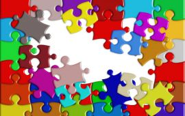 jumbled jigsaw puzzle pieces of many colors