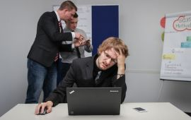 Stressed out man at desk in front of computer