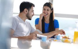 Couple eating at breakfast table