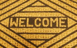 Sisal and black doormat says WELCOME