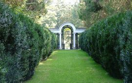 beautiful garden gate at end of lawn