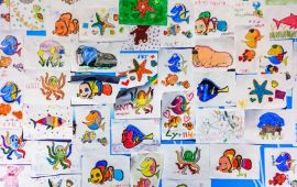 Wall of childrens' art with characters from Finding Nemo