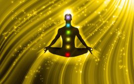 illustration of man meditating floating on golden field with colored chakras
