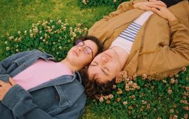 Two men asleep in the grass