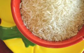White rice in red bowl on yellow plate.