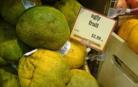 """grocery bin labeled """"Ugly Fruit"""""""