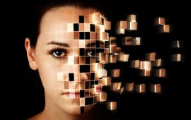 Woman's face breaking up into grid pattern