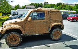 4-wheel drive car completely covered in mud