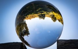 Reflecting lens ball with upside down countryside